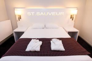 Un ou plusieurs lits dans un hébergement de l'établissement Hotel Saint Sauveur by WP Hotels