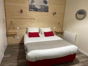 Un ou plusieurs lits dans un hébergement de l'établissement Hôtel Bellevue