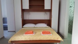 Postel nebo postele na pokoji v ubytování Apartments Matić