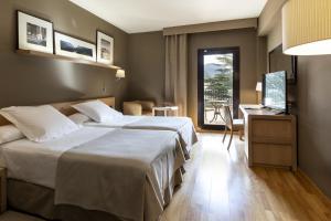 Een bed of bedden in een kamer bij Parador De La Seu D'urgell