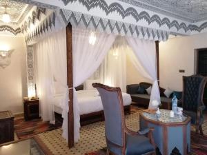 Un ou plusieurs lits dans un hébergement de l'établissement Ksar Elkabbaba