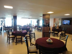 A restaurant or other place to eat at Nord Class Cabo Branco