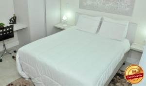 A bed or beds in a room at Letto Hotel & Spa Fonte Ijuí