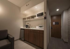 A kitchen or kitchenette at Microtel Inn & Suites by Wyndham