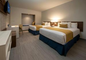 A bed or beds in a room at Microtel Inn & Suites by Wyndham