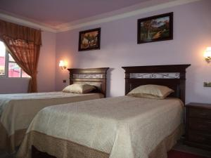 A bed or beds in a room at Apart Hotel Turquesa