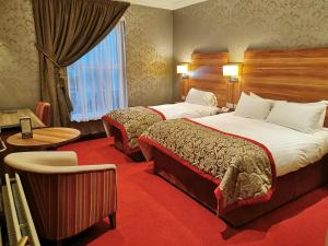 A bed or beds in a room at Sligo Southern Hotel