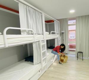 A bunk bed or bunk beds in a room at Alberguinn