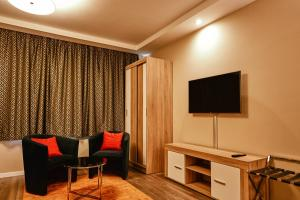 A television and/or entertainment center at Cherry Residence, Palace Quarter