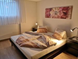 Ein Bett oder Betten in einem Zimmer der Unterkunft Apartment Gornerhaus