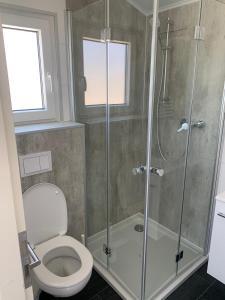 Een badkamer bij STRAND 21 hotelchalets