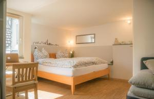 A bed or beds in a room at Altstadt Apartment Centralissimo