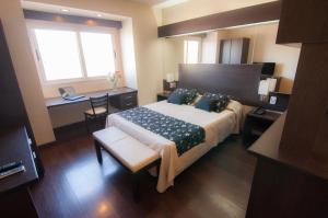Cama ou camas em um quarto em Hathor Hotels Mendoza