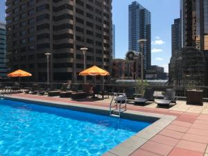 The swimming pool at or near Ramada Plaza by Wyndham Calgary Downtown