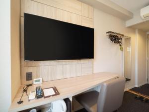 A television and/or entertainment center at Super Hotel Hida Takayama