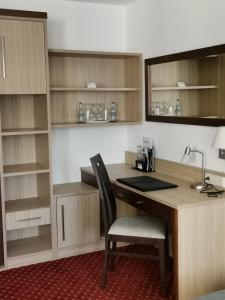 A kitchen or kitchenette at Apart Business Hotel