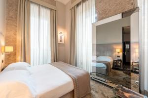 Letto o letti in una camera di DOM Hotel Roma - Preferred Hotels & Resorts