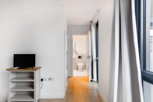 A television and/or entertainment center at Large Sunny Two Bedroom Apartment with Balcony