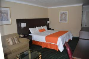 A bed or beds in a room at Knights Inn North Bay
