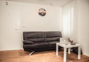 A seating area at Altstadt Apartment Alisa