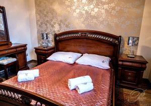Łóżko lub łóżka w pokoju w obiekcie Hotel Polonia