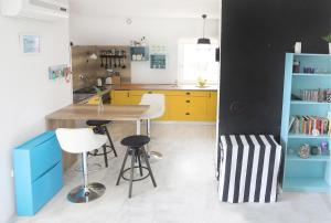 A kitchen or kitchenette at Apartments Skandi1
