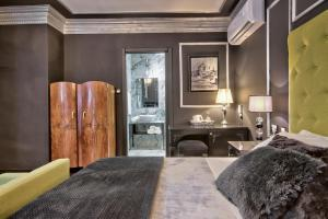 A bed or beds in a room at Julina Boutique Living