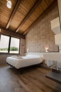 Cama o camas de una habitación en Hostal Rural Casa Nahia