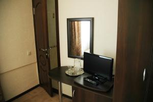 Телевизор и/или развлекательный центр в Anapa-Neptun Resort