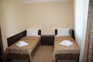 Кровать или кровати в номере Anapa-Neptun Resort