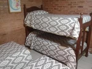 Una cama o camas en una habitación de Casa Quinta Chivilcoy
