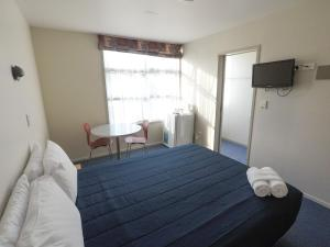A bed or beds in a room at YHA Rotorua