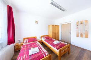 Postel nebo postele na pokoji v ubytování Penziony Beneš