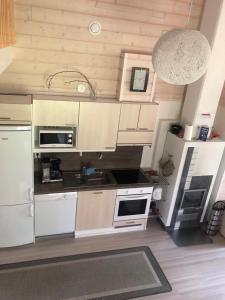 Majoituspaikan Ähtärin lomamökit - AARRE Mökki keittiö tai keittotila