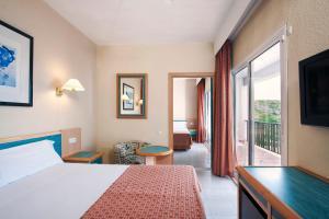 Cama o camas de una habitación en Sol Milanos Pingüinos