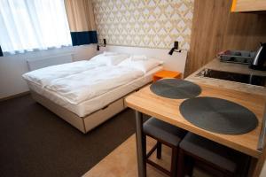 Posteľ alebo postele v izbe v ubytovaní Dom Končiar