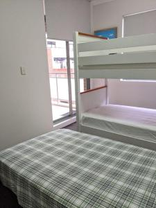 A bunk bed or bunk beds in a room at Comfort HS Apartment - Darling Harbour