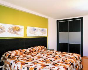 Cama o camas de una habitación en Sol y Sombra
