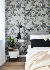 Postel nebo postele na pokoji v ubytování Mermaid Apartment