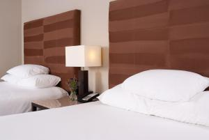 A bed or beds in a room at Hyatt Regency Green Bay