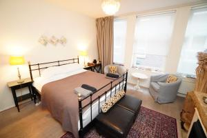 Een bed of bedden in een kamer bij Boogaards Bed and Breakfast