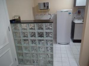 A kitchen or kitchenette at Apartamentos funcional II
