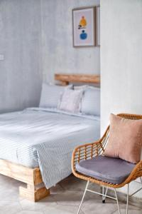 A bed or beds in a room at The Sloth Bali