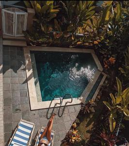 A view of the pool at The Sloth Bali or nearby