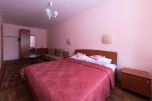 Кровать или кровати в номере Отель Спорт