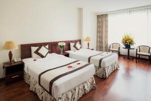 Ein Bett oder Betten in einem Zimmer der Unterkunft River Prince Hotel