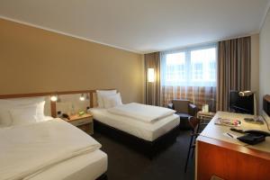 Ein Bett oder Betten in einem Zimmer der Unterkunft Lindner Hotel Dom Residence