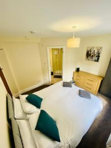 A bed or beds in a room at Cannock House ~ 4 Bedrooms all with ensuite.