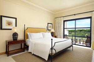 A bed or beds in a room at Pine Cliffs Residence, a Luxury Collection Resort, Algarve