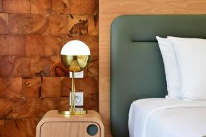 A bed or beds in a room at My Story Hotel Tejo